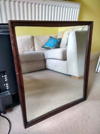 Heavy mirror with wooden frame. Antique / vintage