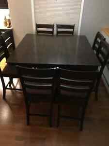 Solid wood pub height table and 8 chairs