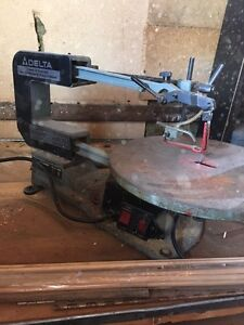 Scroll saw and table sander