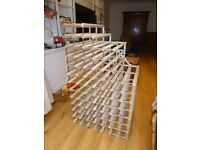 Wine rack - wood and metal. Holds 118 bottles
