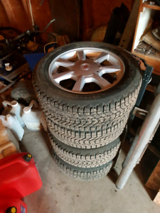 Set of 4 studded winter tires and rims off Cadillac CTS w/tpms