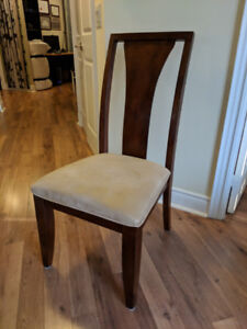 Six wooden fabric-cushioned dining chairs (gently used)