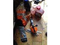 Chainsaw tools and oil