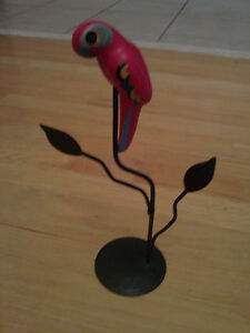 Handmade decorative clay macaw parrot on metal stand
