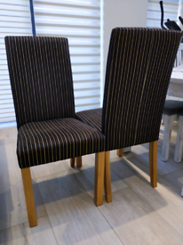 Pair of upholsted dining chairs.