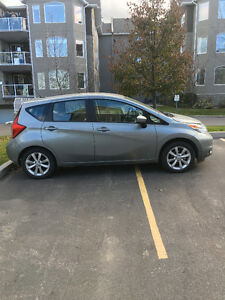 2015 Nissan Versa SL Hatchback (includes winter tires and rims)
