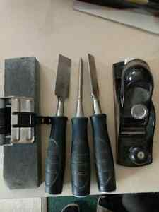 Three set of chisels with sharping stone and planer