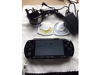 Complete psp with charger and 2 games