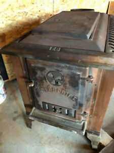 GONE  thanks for all the interest.  FREE wood stove/heater