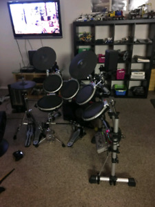 Electric drum kit with double foot pedal.