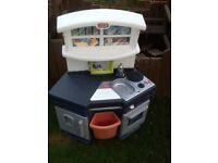 Plastic play kitchen
