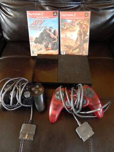 Playstation 2 slim avec 2 jeux et 2 manettes