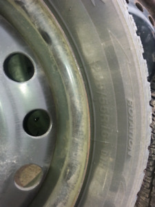 06-18 Honda civic rims an directional winter tires !