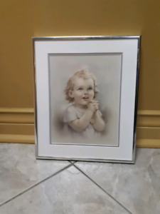 Picture frame. Girl praying