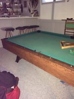 Pool table and balls and cues
