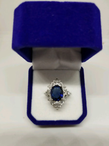 Large blue and white sapphire ring.  14k white gold