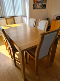 Ercol extending dining table and six Ercol chairs