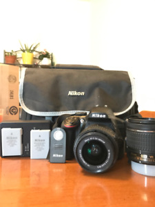 DSLR NIKON D3400 w 2 batteries, remote and bag.
