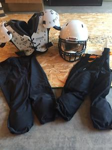 Riddell helmet, Pro Team shoulder pads, black pants with pads