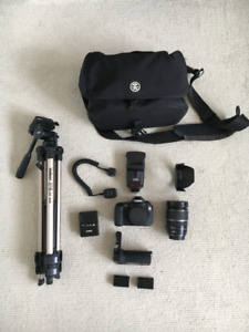 Canon 60D DSLR, f/2.8 lens, speedlite, tripod, and more