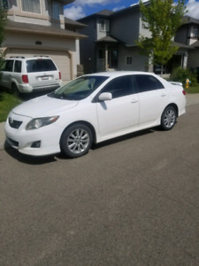 White manual 2009 toyota Corolla