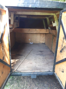 Trailer with enclosed carrying space.