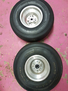 Two lawn tractor tires and rims.