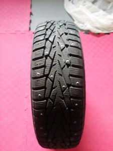 Studed winter tires with rims.