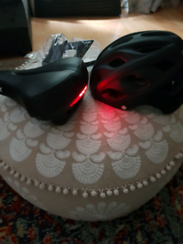 As new padded bike seat with light and helmet with visor