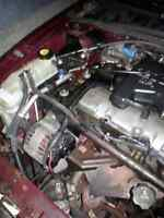 2001 Cavalier 2001 door automatic , running as is for parts