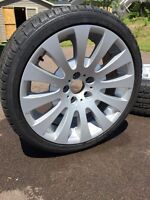 """4 BMW 18"""" rims with winter tires"""