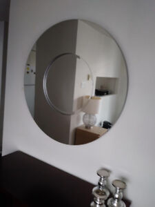 A beautiful round mirror with potential of becoming 2 mirrors