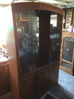 Wooden/glass cabinetry w/ mirror and light
