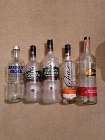 10 Empty vodka bottles for crafting.