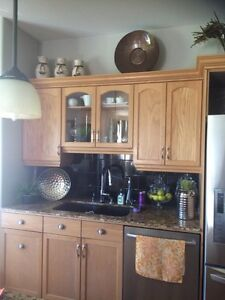Cabinets and granite counter tops and sink.