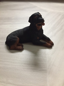 CUTE ROTTWEILER FIGURINE LAYING DOWN