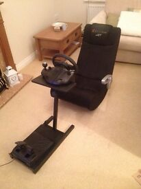 Gaming chair with steering wheel and pedals