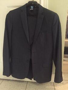 Men's suit size 38 jacket, 2 pairs of pants size 30,32