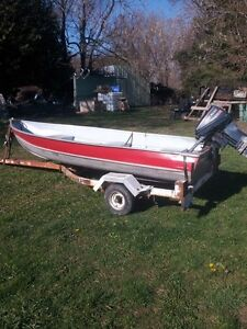 12 foot aluimum boat / 15 hp evinrude and trailer