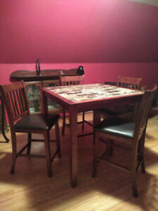 Pub style table with 4 chairs.