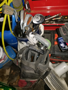 Youth golf clubs and bag left