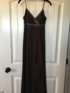 Long brown gown, with jeweled embellishment