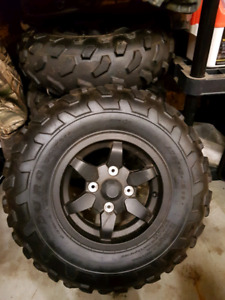 Almost new stock 2013 brute force rims and tires