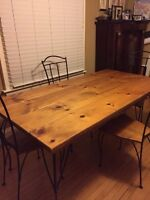 Solid wood (pine) and wrought iron - dining table and 4 chairs
