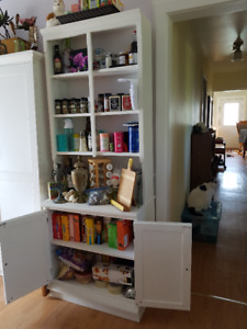 Matching book shelves with storage on bottom.