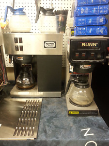 2 bunn coffee brewers ,thermos's 5 plexi coffee containers etc