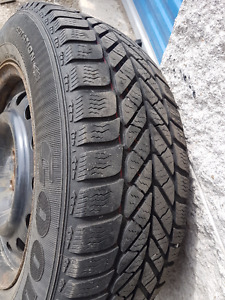 "15"" Goodyear winter tires on rims 205/65 R15"