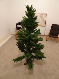 Artificial Christmas tree! 5' with heavy cast iron base, bargain!