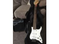 Black fender squire stratocaster with 10w amp