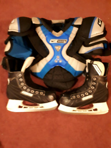 Size 5 Bauer skates with chest protector asking $80.9024406092